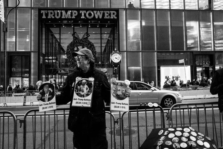Donald Trump Trump Tower Architecture Building Exterior Built Structure Car City Communication Day Land Vehicle One Person Outdoors People Real People Text Transportation Trump Protest