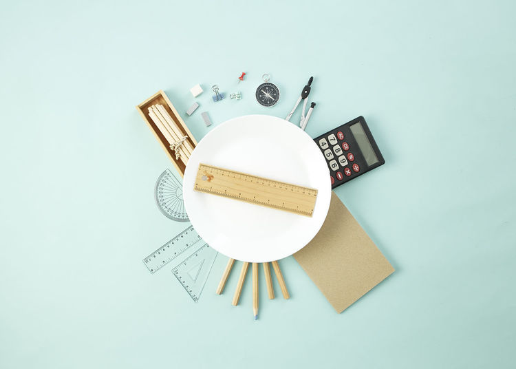 Back to school concept, empty white dish with pencil case with various stationery on on pastel pale blue background. copy space for tex School Education Desk Book Concept Table Background Classroom Notebook Supplies Stationery Study Teacher Pencil Class Pen Office Student Color Board Colorful Chalkboard Stack Kids Library Business Elementary Studying University Nobody Design Flat Lay Text Copy Space Flat Design Top View Workplace Minimal Art Back To School Indoors  Studio Shot Still Life High Angle View No People Directly Above Close-up Cut Out White Background Communication Colored Background Blue Blue Background Technology Wood - Material Group Of Objects Creativity