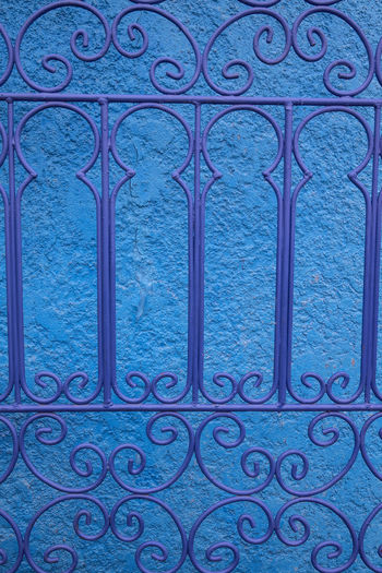 Blue Pattern No People Design Metal Full Frame Closed Architecture Day Safety Built Structure Security Backgrounds Close-up Protection Outdoors Religion Shape Ornate Floral Pattern Glass Wrought Iron Morocco Textured