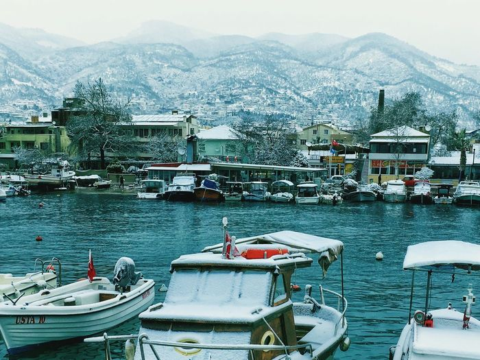 snow Outdoors Nautical Vessel Transportation Water Boat Mountain Nature Sky