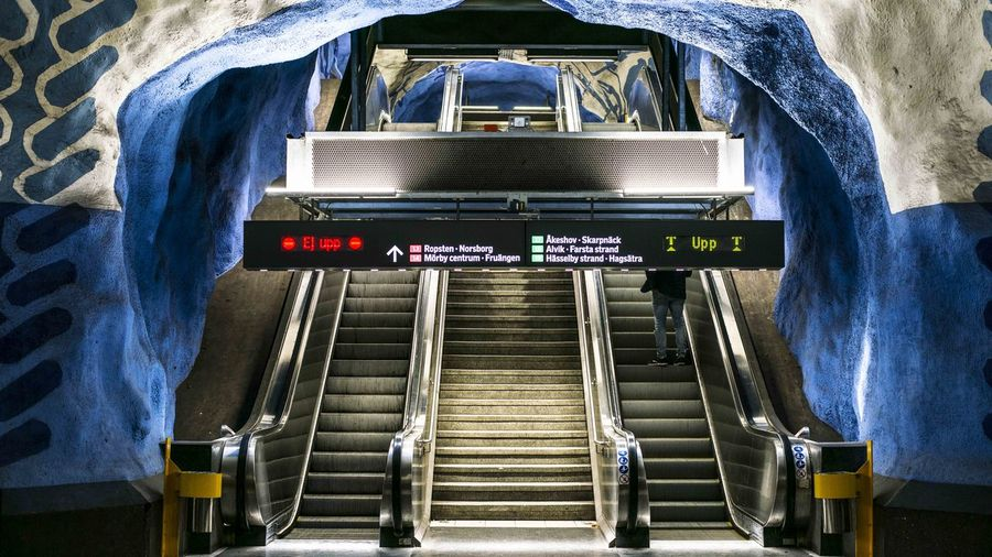 Marcweberde Text Indoors  Communication Architecture Technology Staircase No People Western Script Escalator Steps And Staircases Transportation Convenience Public Transportation Railing High Angle View Sign Built Structure Travel Subway Station Blue