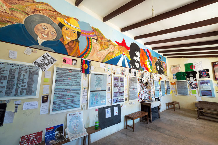 LA HIGUERA, BOLIVIA - AUGUST 6: Interior of the school where revolutionary Che Guevara was executed in La Higuera, Bolivia seen on August 8, 2014 Argentina Argentinean Bolivia Che Guevara Communism Cuban Ernesto Che Guevara Guerrilla History La Higuera Large Group Of Objects Memorial Monument Multi Colored Prison Revolution Revolutionary Revolutionary War School South America Town Travel Vallegrande