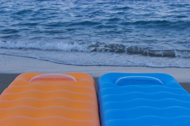 Aquatic Sport Beach Beauty In Nature Blue Day Holiday Inflatable  Motion No People Relaxation Sand Sea Sport Tranquility Water Waterbed Wave