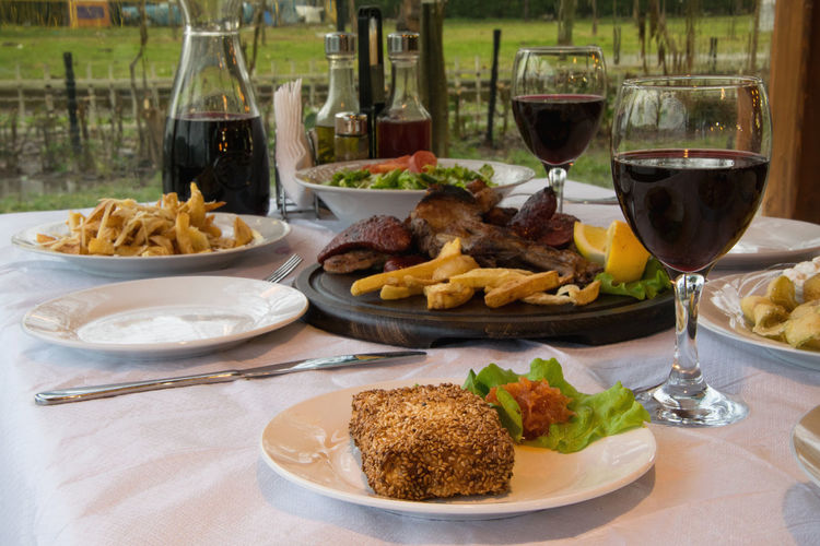 Beverage Dish Event Food And Drink Lunch Meal Red Wine Abundance Calories Delicious Food Gourmet Greek Food Location Meat Ready-to-eat Restaurant Restaurant Food Traditional