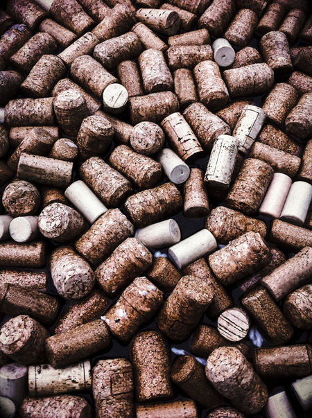 Wine corks floating on water Abundance Alchol Backgrounds Backgrounds Wood Brown Close Up Color Cork Day Floating On Water Food And Drink Industry Large Group Of Objects Many No People Overhead View Pattern Recycling Water Wine Bottle Wine Cork Wood - Material