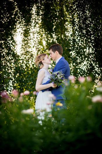 Bride And Bridegroom Romancing At Park