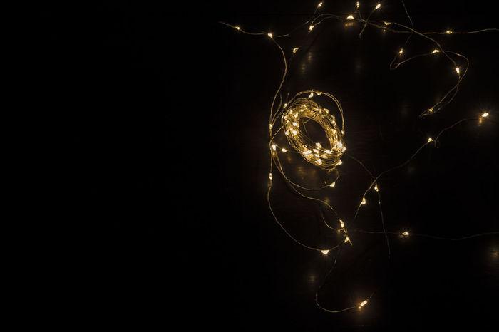 Christmas Christmas Lights Filament Lights Light Lights Backgrounds Black Background Christmas Decoration Electricity  Filament Filament Light Illuminated Indoors  Night No People Shadow Yellow Yellow Light
