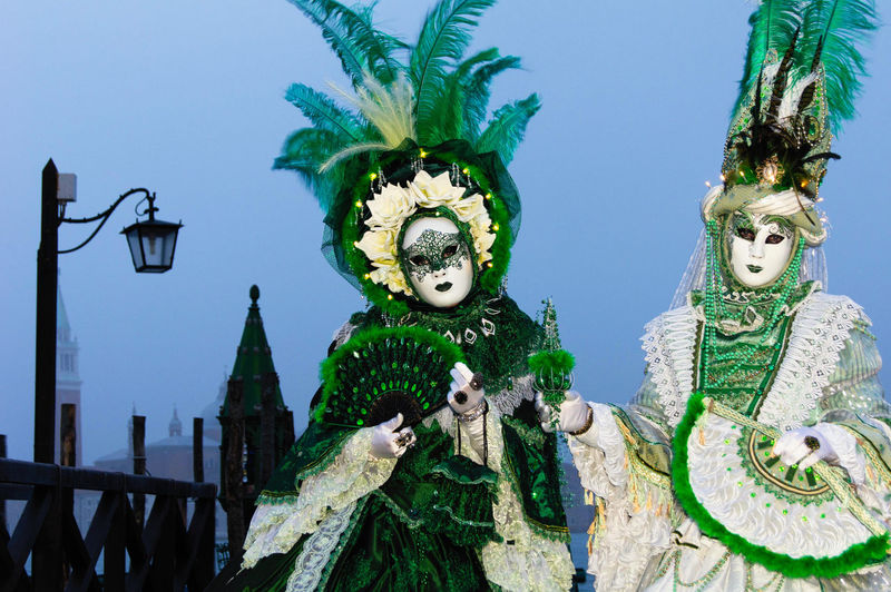 Carnival in Venice Canal Grande Carnival In Venice Green Venice, Italy Architecture Building Exterior Built Structure Costumes Day Human Representation Low Angle View Mask - Disguise Outdoors Sky Statue Venetian Mask The Street Photographer - 2018 EyeEm Awards The Portraitist - 2018 EyeEm Awards