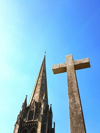 Low angle view of st martin church and cross against clear blue sky