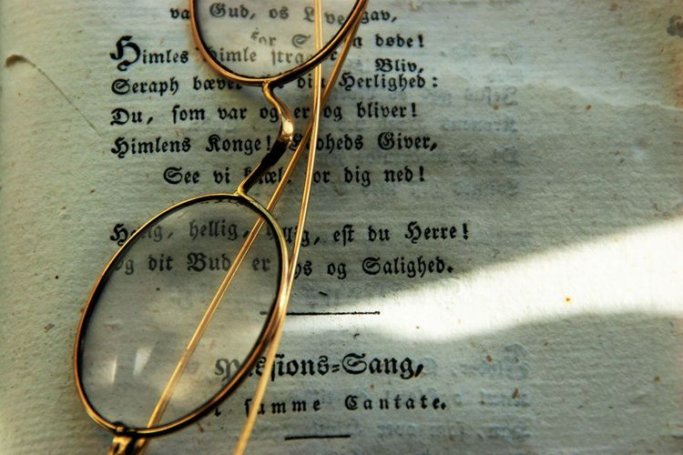 Antique Glass Book Close-up Glasses Literature No People Old Book Page Paper Religion Symbol Text