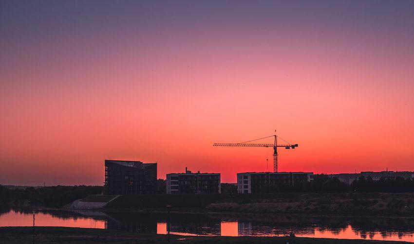 kaunas construction Construction Red Color Sunset City Water Sunset Urban Skyline Cityscape Technology Silhouette Sky