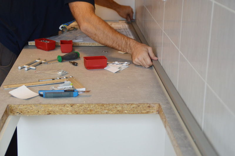 Close-up of craftsperson working on table