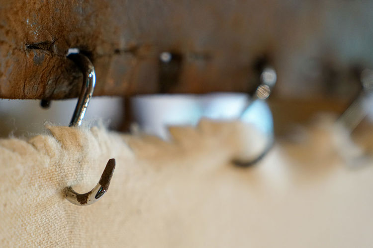 Close-up of faucet hanging on wall