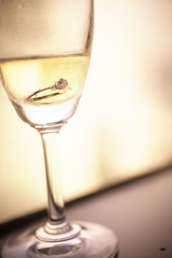 Close-Up Of Ring In Champagne Flute