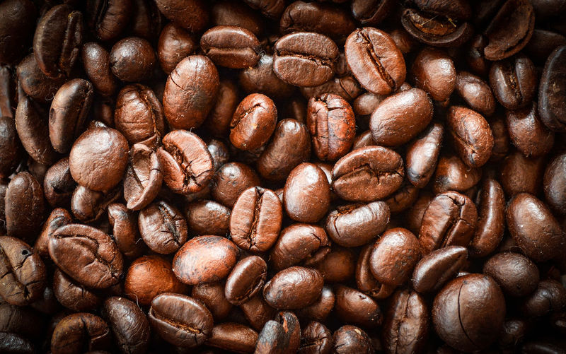 Close up of Coffee beans roasted texture background - top view Agriculture Arabica Aroma Background Bean Beans Beverage Black Breakfast Brown Cafe Caffeine Cappuccino Close Close-up Closeup Coffee Color Crop  Dark Drink Energy Espresso Flavor Food Fresh Freshness Gourmet Grain Group Hot Ingredient Light Macro Mocha Morning Natural Nobody Pattern Raw Roast Roasted Roaster Roasting Seed Space Texture Textured  View White