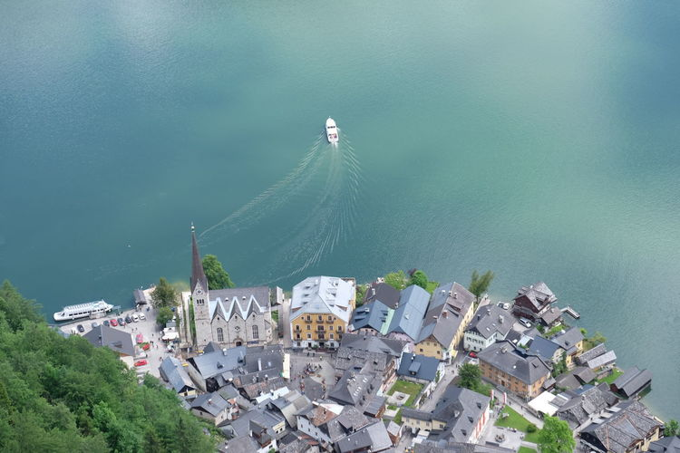 High Angle View Of Boat Moving By Townscape