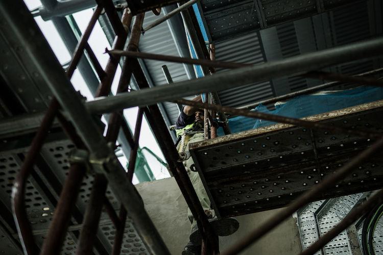 Low angle view of man on bridge