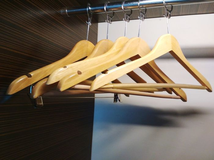 Clothing hangers Wardrobe Wooden Hanger EyeEm Selects Hanging Coathanger Wood - Material No People Retail  Store Business Finance And Industry Indoors  Clothing Day