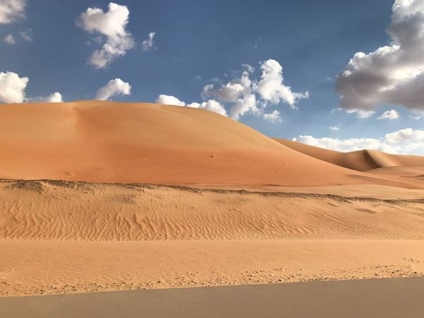 rare phenomenon Clouds Over Desert Rub Al Khali Sand Sand Dune Nature Desert Sky Arid Climate Landscape Cloud - Sky Tranquil Scene Non-urban Scene
