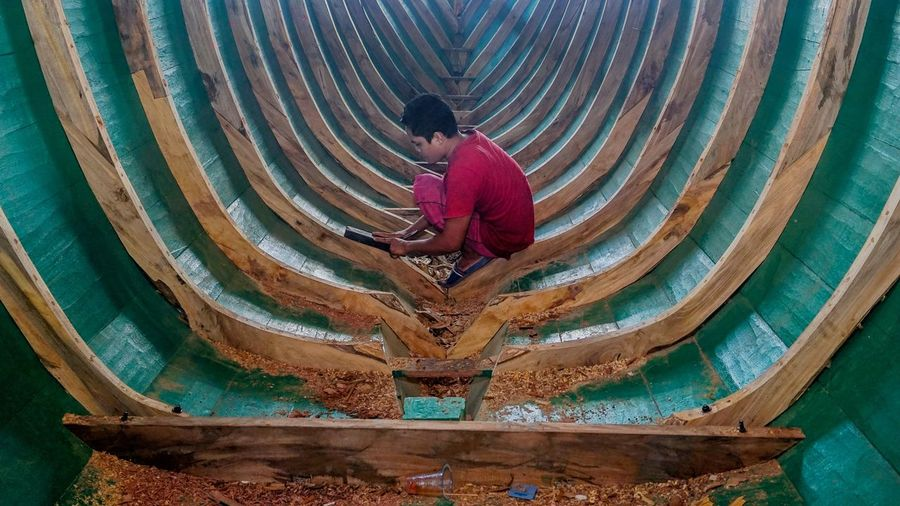 High angle view of man working in water