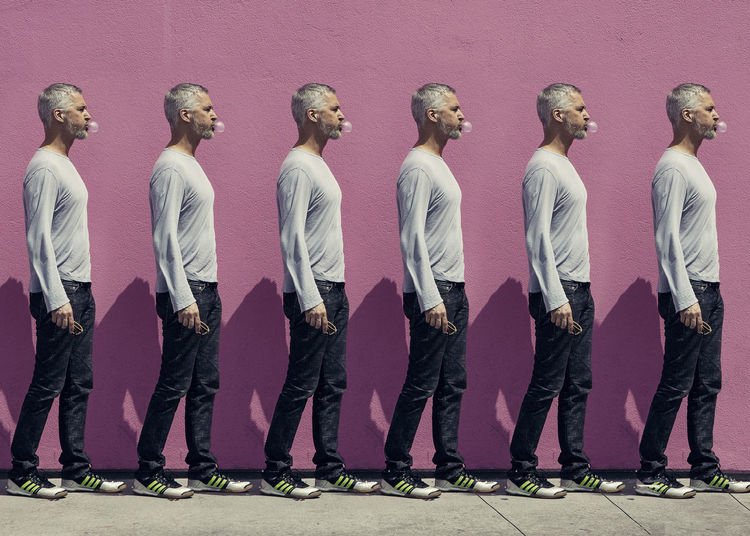 Repeated Pattern of the same man blowing bubbles. #Bubblegum #Pink  #pinkwall #repetition Multiplicity Adult Colored Background Full Length Fun Humor In A Row Men Real People Side By Side Standing