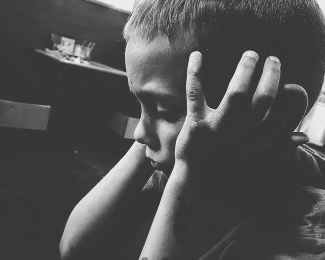 Close-Up Of Sad Boy At Home