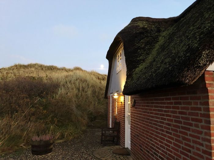 Danish moonshine Nature Is Truth Moonlight Thatched Roof Sky Plant No People Nature Architecture Day Landscape Building Exterior Built Structure Nature House Grass Tranquil Scene