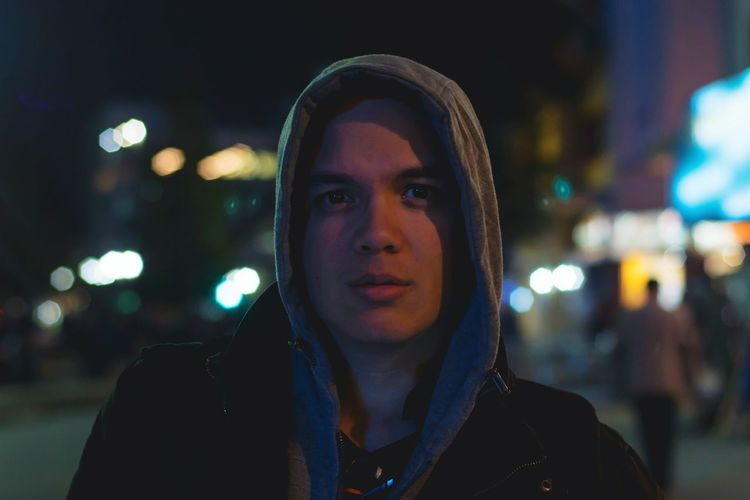 Night Headshot Illuminated Front View Adult Adults Only One Person Portrait People Young Adult Outdoors Street City City Street Handsome City Life Focus On Foreground Handsome Man Cold Temperature Young Men Warm Clothing Hood - Clothing Hooded Shirt Street Photograpy The Portraitist - 2017 EyeEm Awards