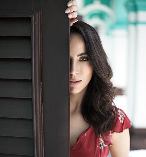 Portrait of beautiful woman standing in corridor