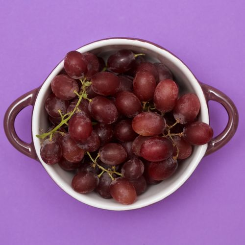 Grapes in a purple bowl on a purple background Bowl Close-up Food Freshness Fruit Grapes, Healthy Eating No People Organic Purple Background Still Life