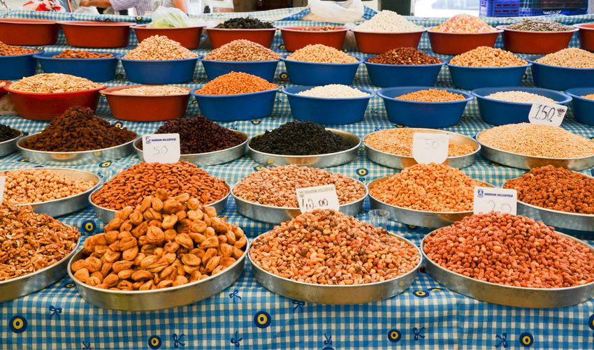 Various fruits and spices for sale at market stall