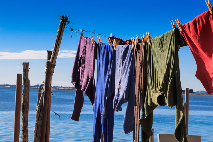 Clothes Drying On Clothesline Against Seascape
