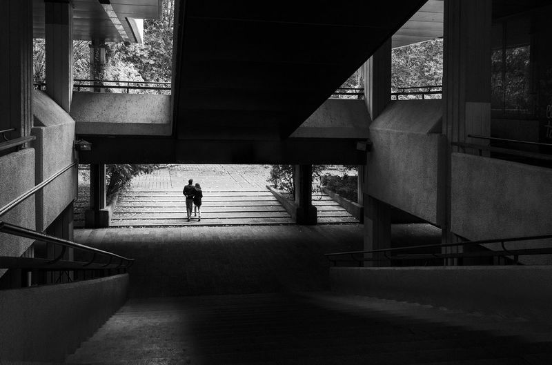 Couple between lights and shadows Full Length Silhouette Walking Architecture Built Structure