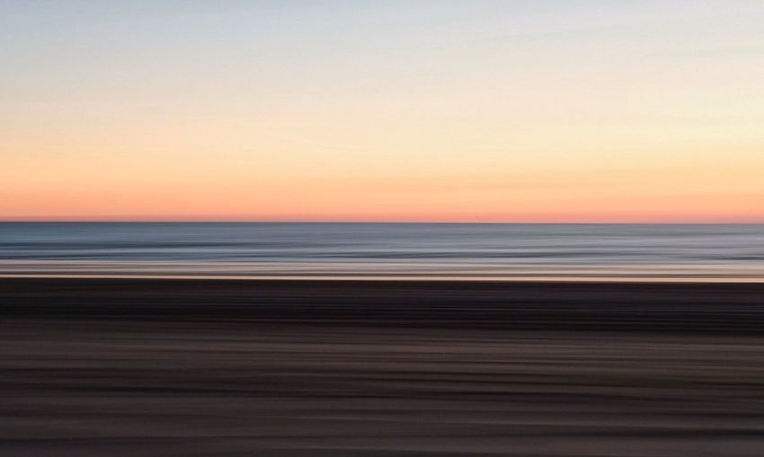 Sea Sunset Beach Horizon Over Water Scenics Nature Beauty In Nature Tranquil Scene Tranquility Sand Outdoors Sky Water Travel Destinations Dusk No People Summer Travel Landscape Vacations Panning Panningphotography Panning Photography Abstract Abstract Photography EyeEmNewHere