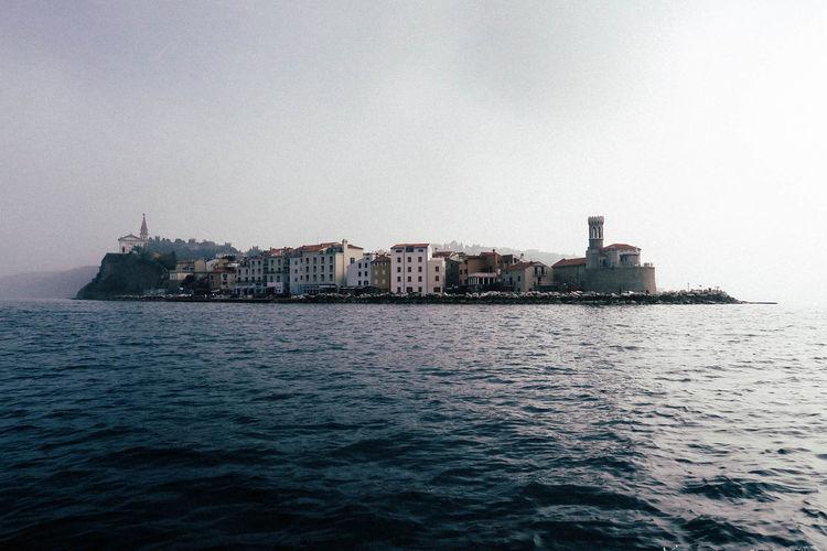City Cityscape Coastal Life Harbor Houses Mediterranean  Slovenia Travel Travel Photography Boats Coast Day No People Outdoors Sea Sea And Sky Sky Travel Destinations Vacation Village Water