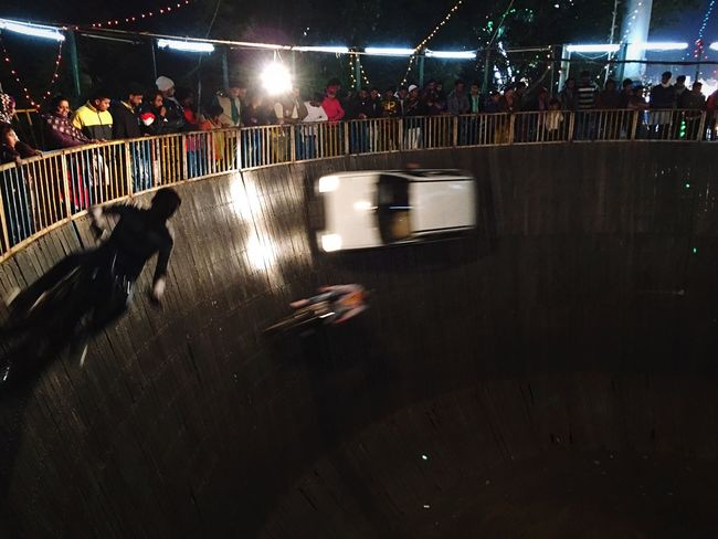 Death defying daredevils Pit Of Death Wall Of Death Knightrider Ride Or Die Ride Dangerous Stunt Daredevil Adrenaline Junkie Adrenaline Capturing Movement RISK Getting Inspired Night Night Lights Nightphotography Check This Out EyeEm Best Shots Taking Photos Light And Shadow Mobilephotography IPhoneography On The Move Eye4photography  Photography In Motion