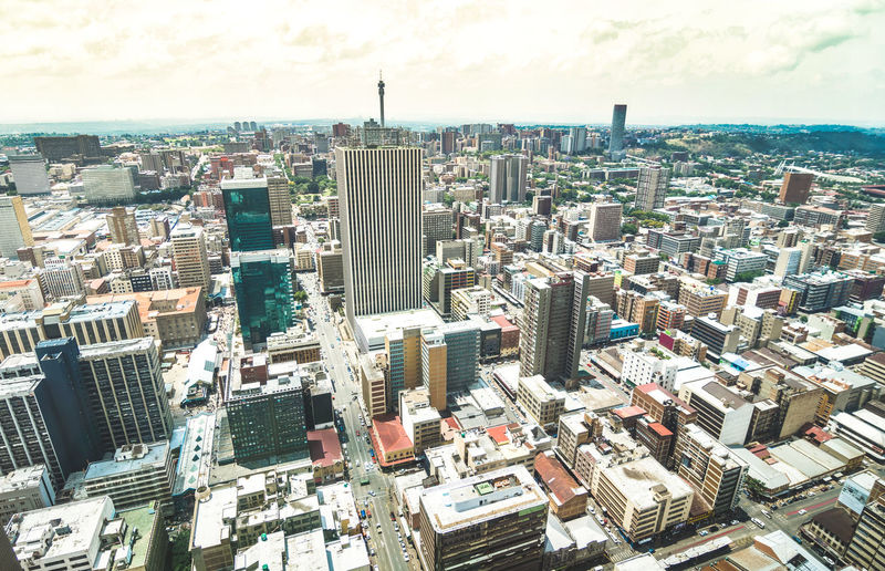 Aerial view of skyscrapers in business district of Johannesburg - Architecture concept with modern buildings of skyline in South Africa biggest city Johannesburg City Cityscape Skyline Township Aerial View Africa Johannesburg South Africa South Africa Filter World Landscape Drone  Travel Urban Suburbs Downtown Center Skyscrapers