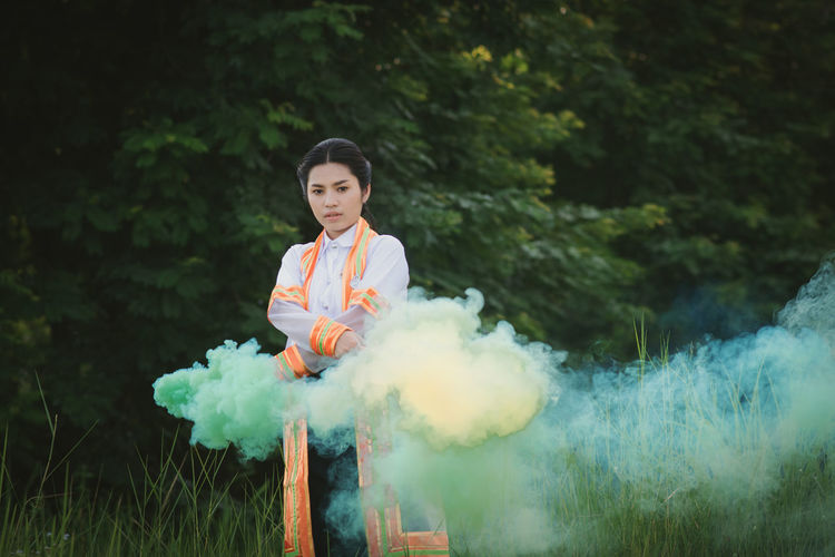 Smoke Clothing Day Front View Green Color Lifestyles Looking At Camera One Person Outdoors Portrait Real People Smoke - Physical Structure Standing Young Adult