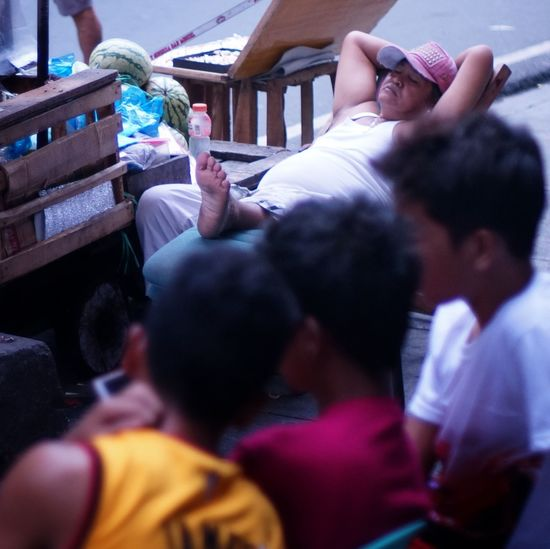 The Week On Eyem Selective Focus Real People Market Street Photography Street Vendor Cubao Quezon City Philippines Sleeping Nap