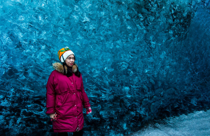 Woman visiting a blue ice cave in Iceland Woman Ice Cave Iceland Chinese Asian Girl One Person Clothing Looking At Camera Nature Women Portrait Water Warm Clothing Front View Adult Hat Cold Temperature Winter Day Happiness Leisure Activity Hairstyle Outdoors Jökulsárlón Jökulsárlón Glaciar Lagoon