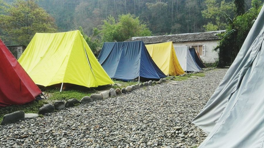 Tenting in the mountains of Nepal. Backpackingescapades Traveling In Nepal Nepal Asia Tenting Mountains In Background