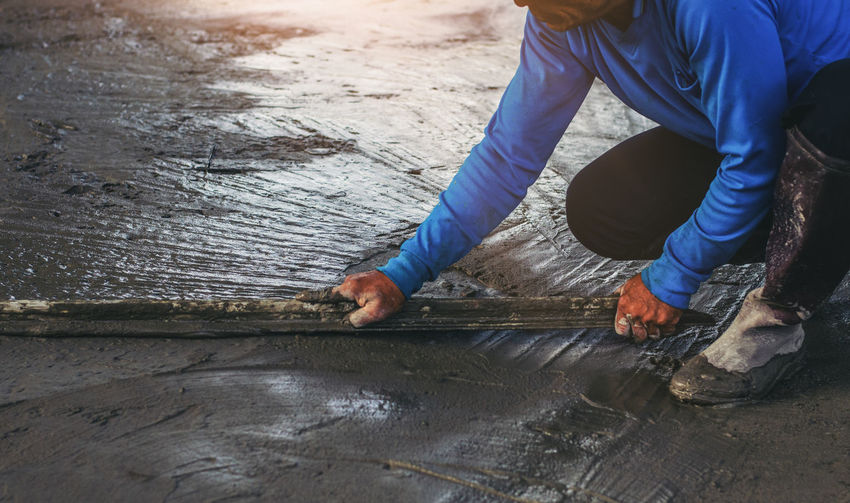 Real People Working One Person Occupation Men Wood - Material Day Outdoors Industry High Angle View Human Body Part Construction Industry Metal Skill  Nature Wood Body Part