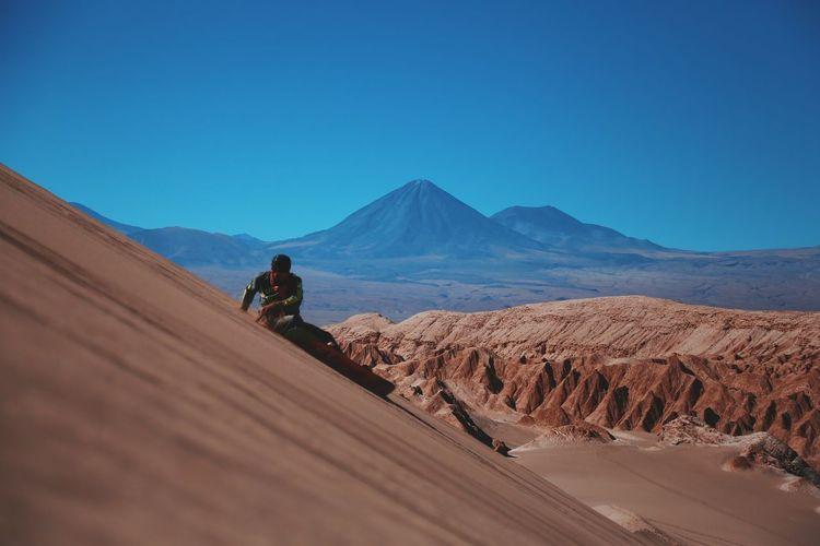 Man On Desert Against Clear Blue Sky