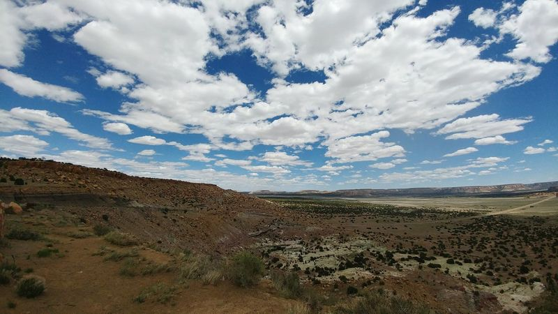 Landscape Cloud - Sky Nature Scenics Desert Outdoors Sky Day No People Beauty In Nature Arid Climate Rural Scene American Southwest Backgrounds EyeEm Best Shots - Nature Flat Land New Mexico Explore Tranquility Road Trip Lonely Nature Photography Scenic View Alone Clouds & Sky
