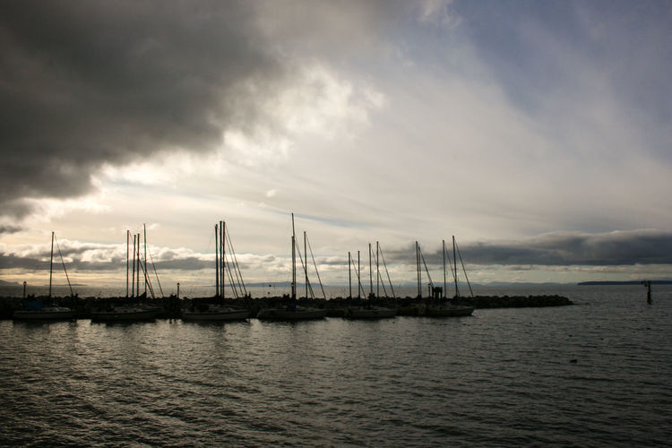 Cloud - Sky Sea Water Outdoors No People Industry Boots Pacific Ocean Pacificocean Whiterocksbeach Nautical Vessel Nature Sunset Tranquility Business Finance And Industry Sky Shipping  Sailboat Scenics Harbor Commercial Dock Day Storm Cloud Horizon Over Water EyeEmNewHere
