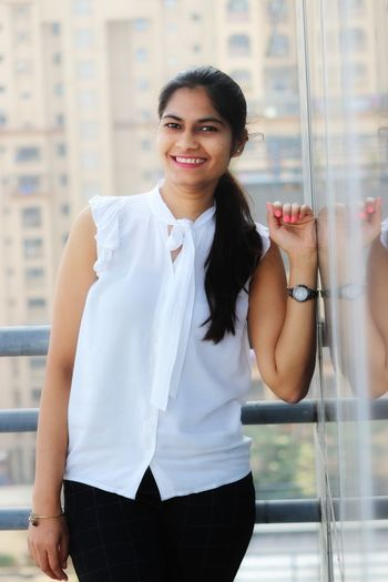 Portrait of a smiling young woman standing outdoors