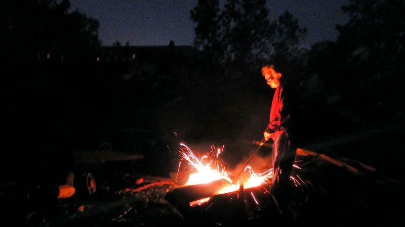 Cutting steel Outdoors Scrap Metal Scrap Yard Fire Steel Sparks Man Work Night
