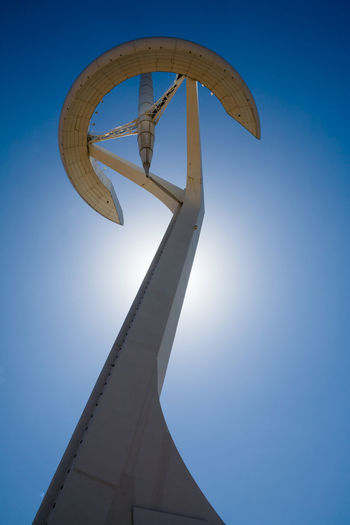 Telecommunications tower photographed from ground with blue sky in background Architecture Backlighting Barcelona Blue Building Exterior Built Structure Clear Sky Day Low Angle View No People Outdoors Sunlight Telecommunication Telefónica Tower