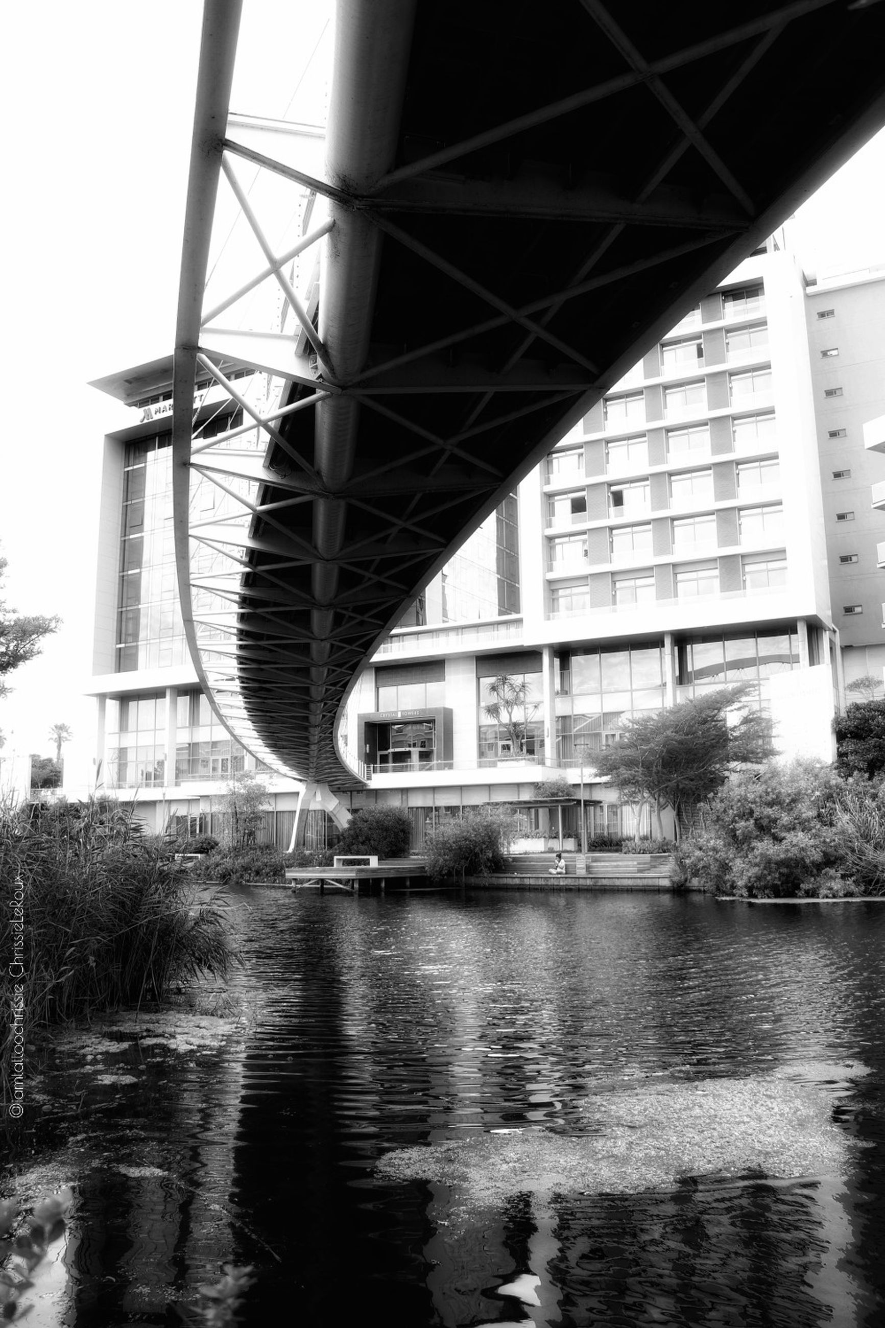 architecture, built structure, water, building exterior, bridge, river, connection, bridge - man made structure, city, transportation, no people, nature, waterfront, reflection, day, building, outdoors, sky