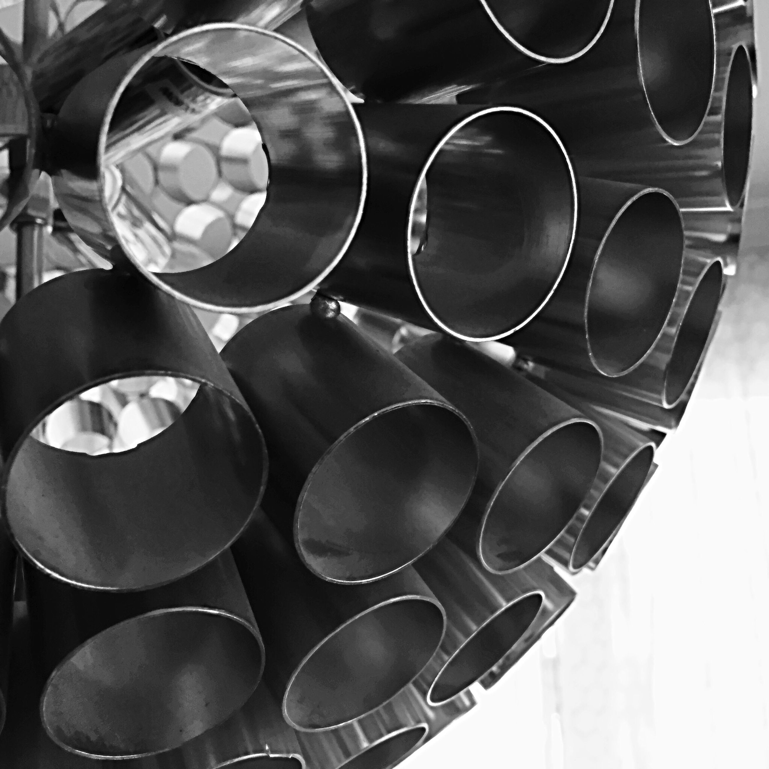 large group of objects, in a row, abundance, arrangement, order, repetition, indoors, circle, variation, stack, still life, multi colored, close-up, shape, no people, pattern, choice, geometric shape, side by side, full frame